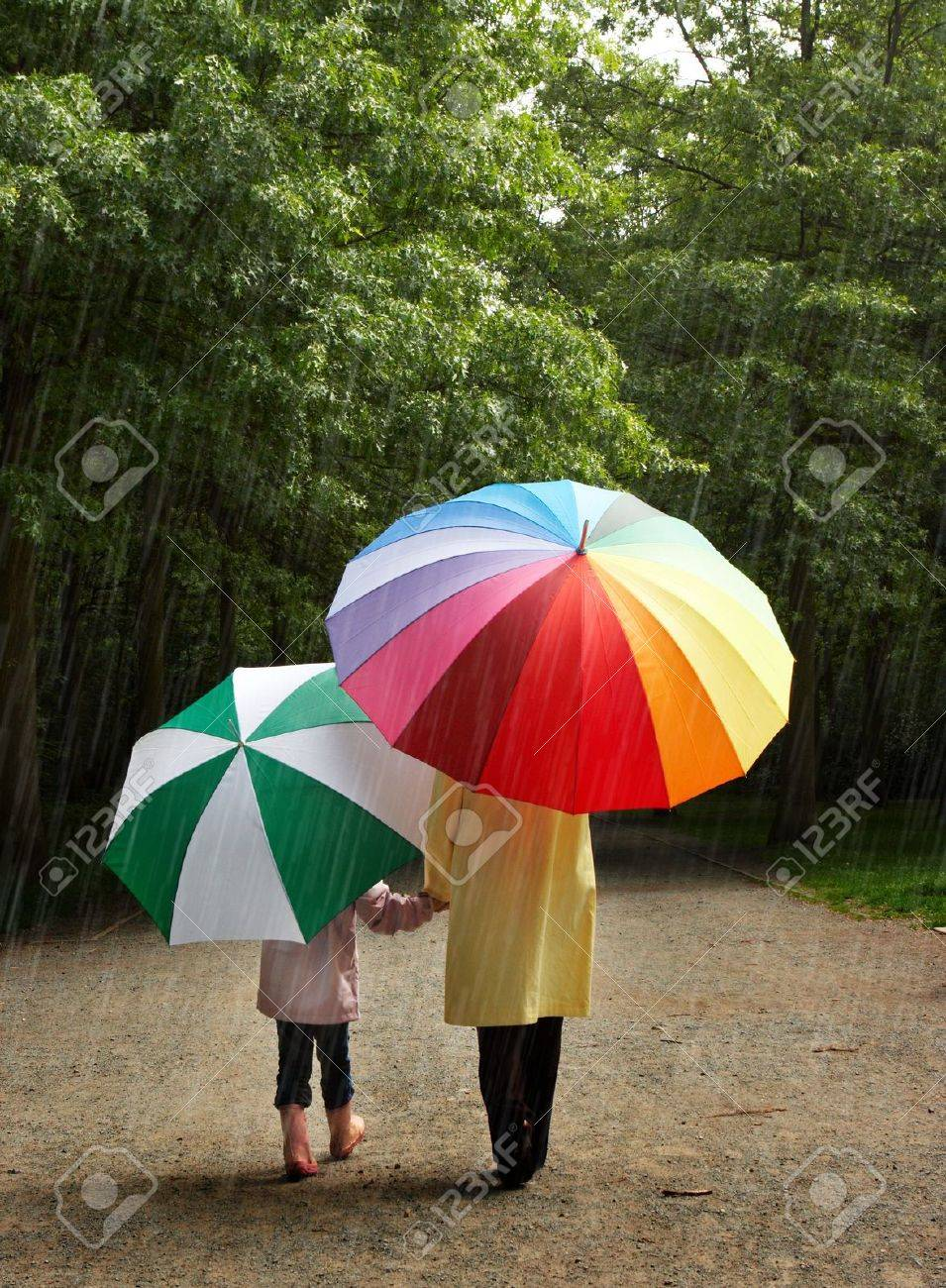 little and her mother in the rain stock photo picture and