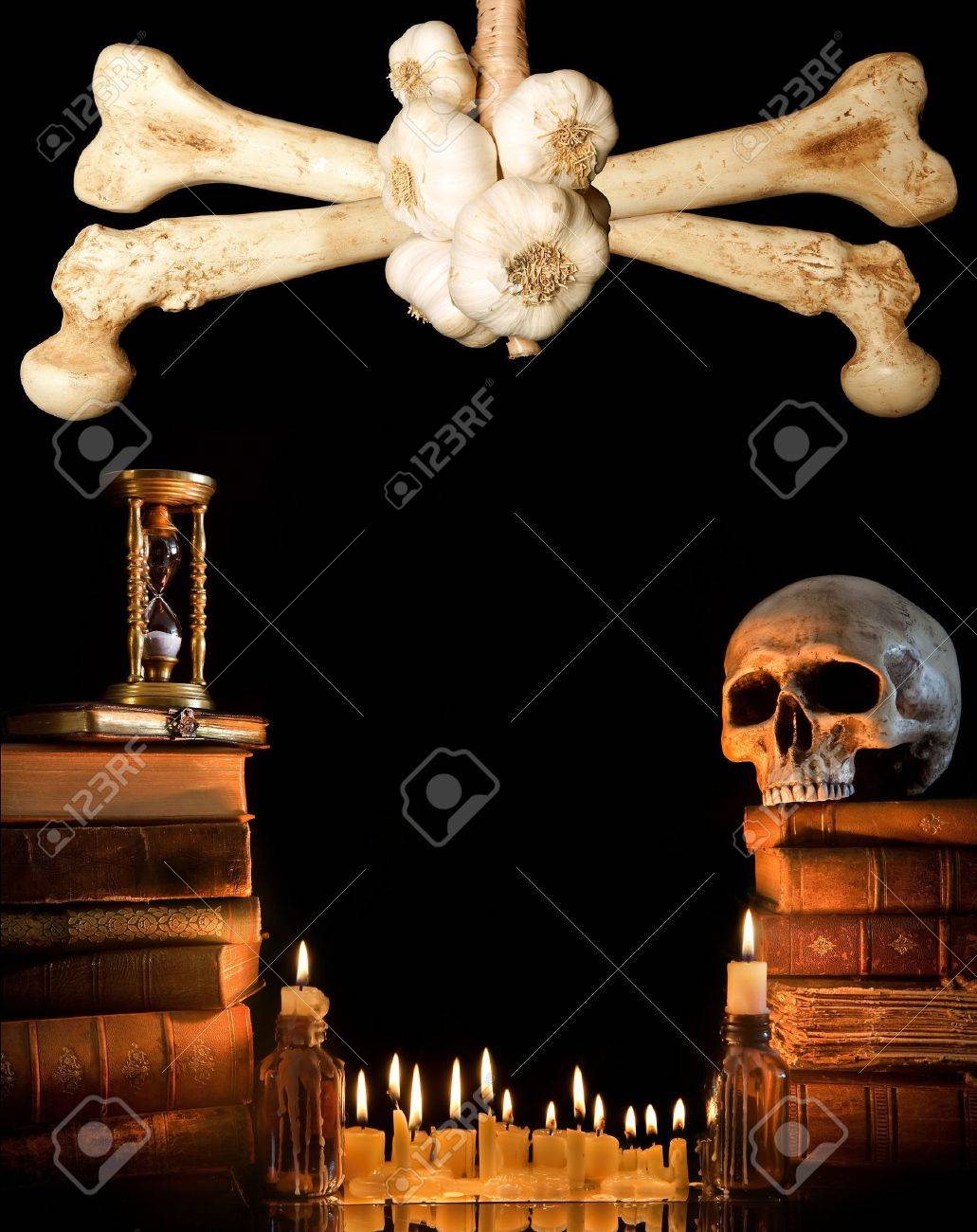 Halloween border with skull, ancient books and candles Stock Photo - 5535660