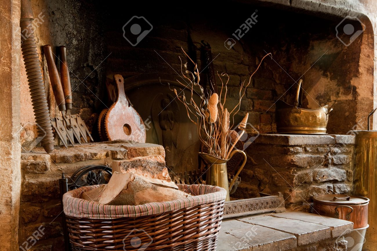 18th century rustic country fireplace in england stock photo