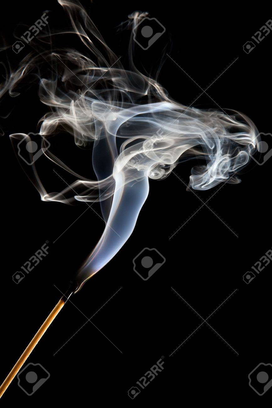 Single match stick being blown out with a wisp of smoke Stock Photo - 5601602