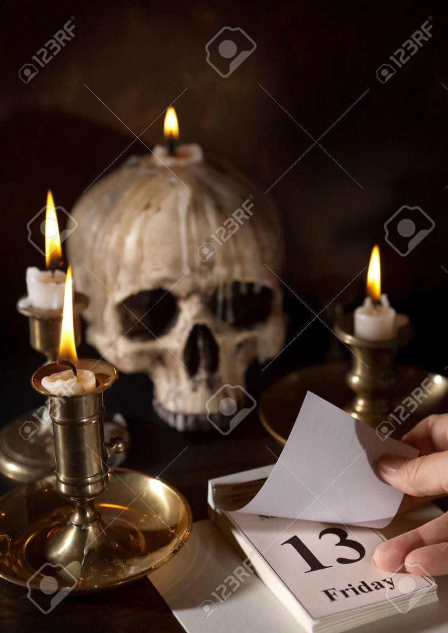 Friday 13th on a calendar with candles and a creepy skull Stock Photo - 5644067