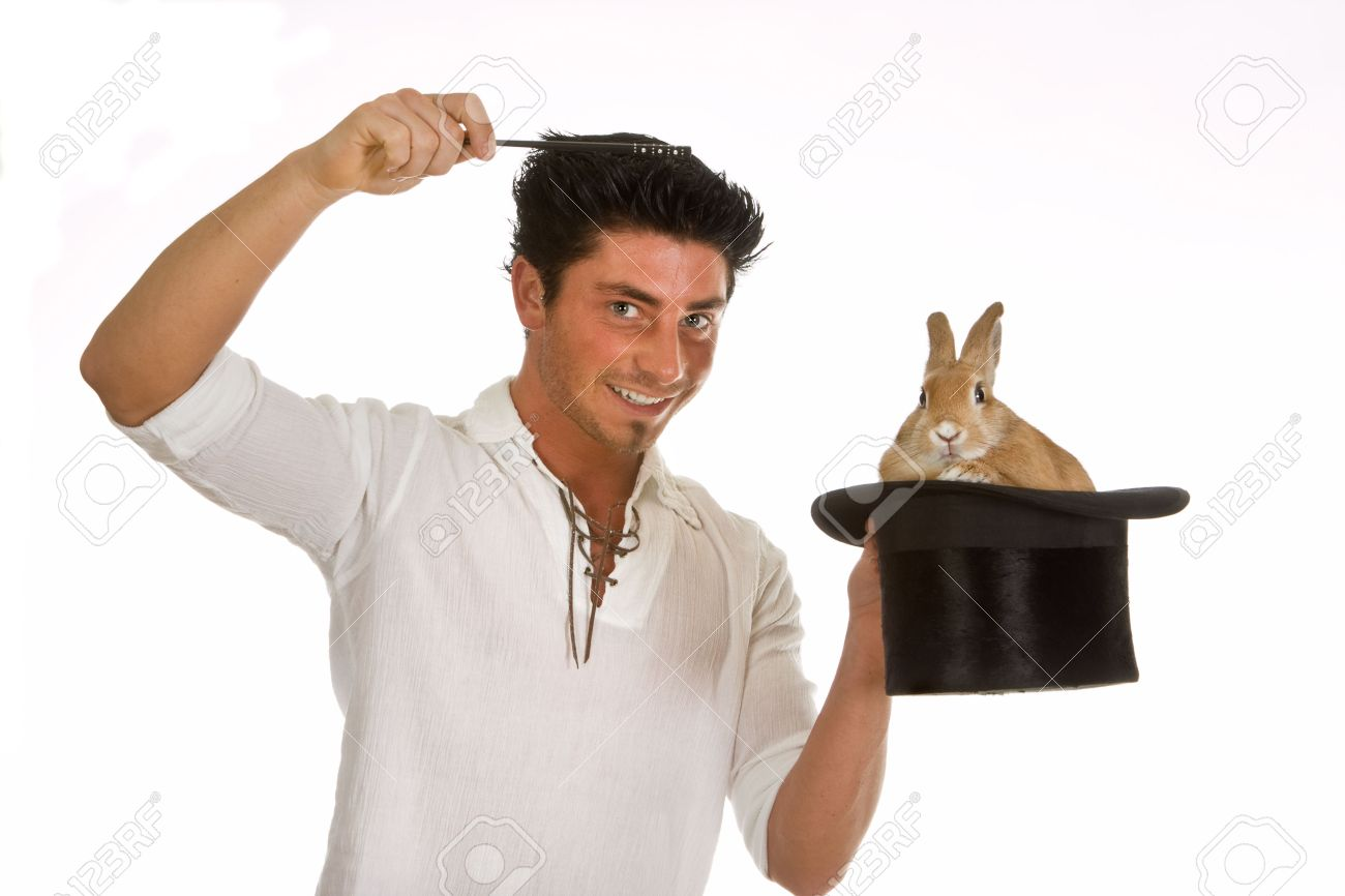 Young man holding a magic wand above a rabbit in a top hat Stock Photo - 6469214
