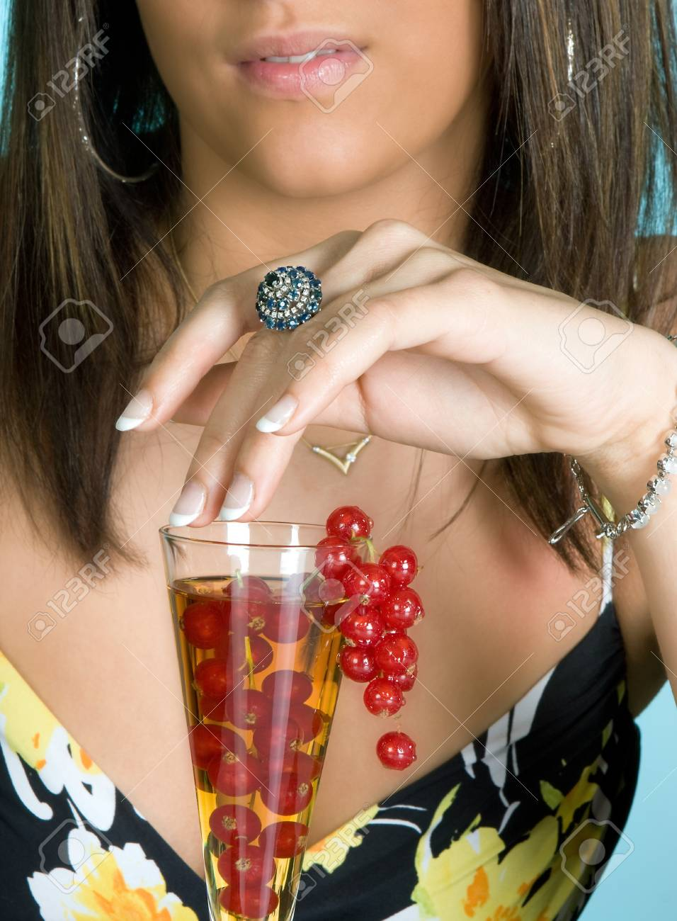 Young brunette touching a fruit cocktail with her hand Stock Photo - 7003183