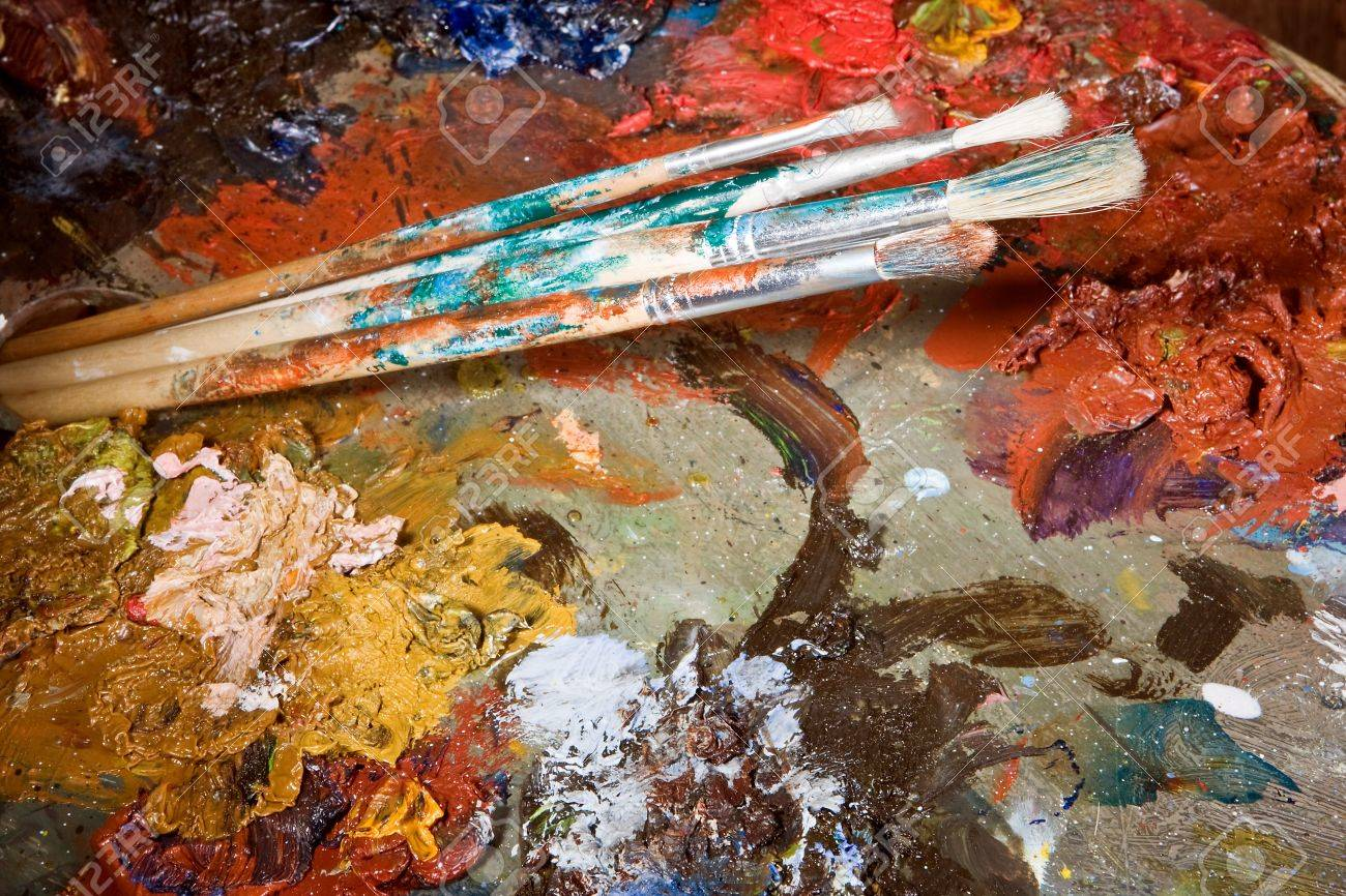 Painter's brushes and colorful almost abstract pallet full of paint Stock Photo - 7117667