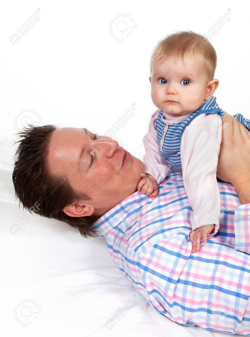 Four months old baby girl sitting on her father's belly Stock Photo - 7117613