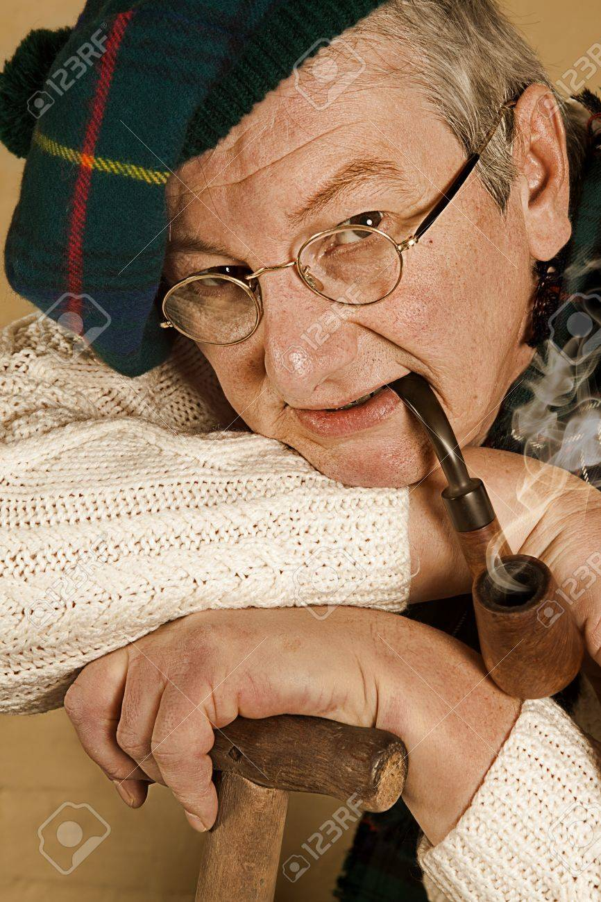 Old scottish man with tartan beret and pipe Stock Photo - 7158076