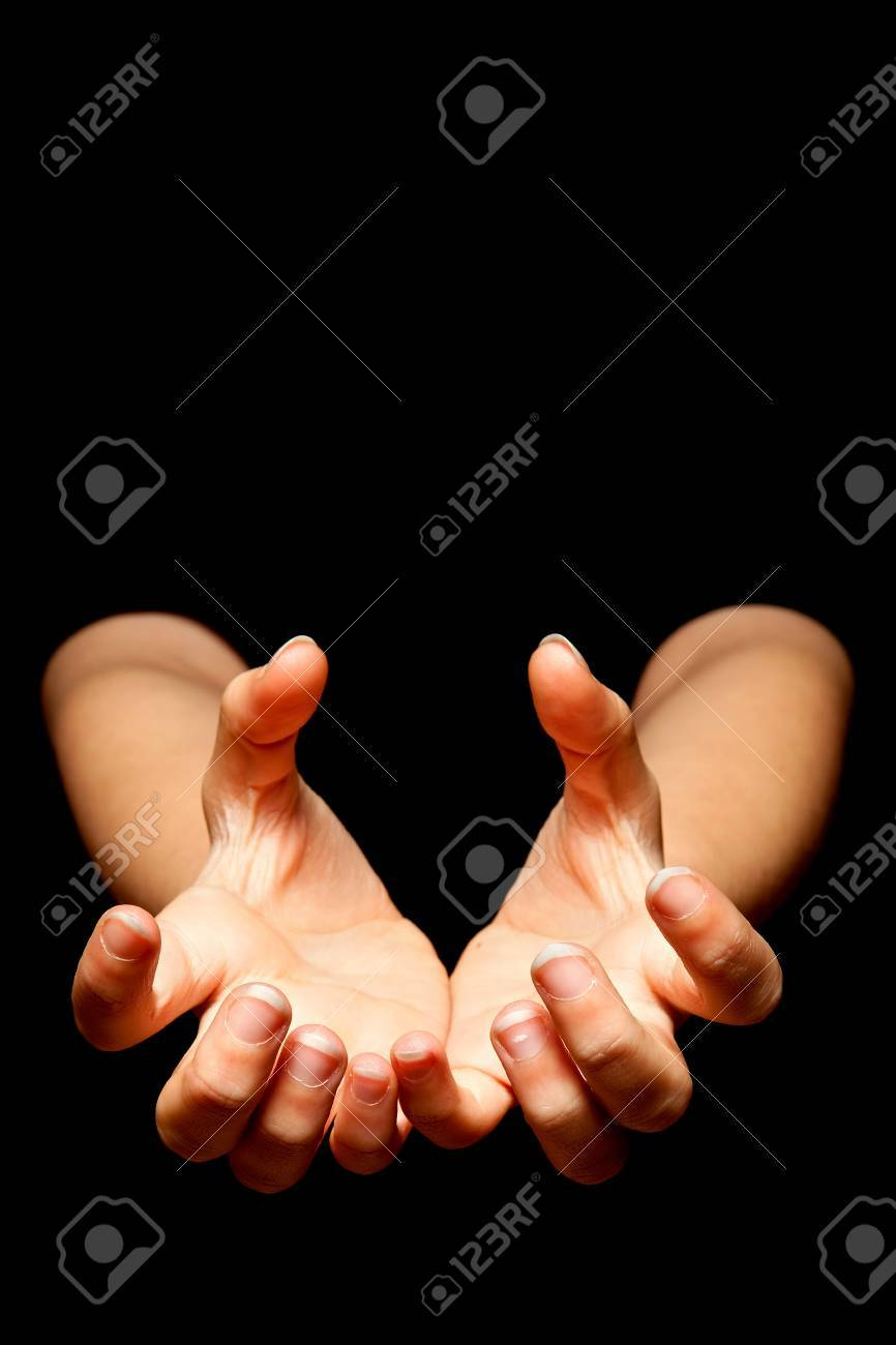Female hands reading to catch something in the darkness Stock Photo - 7214782