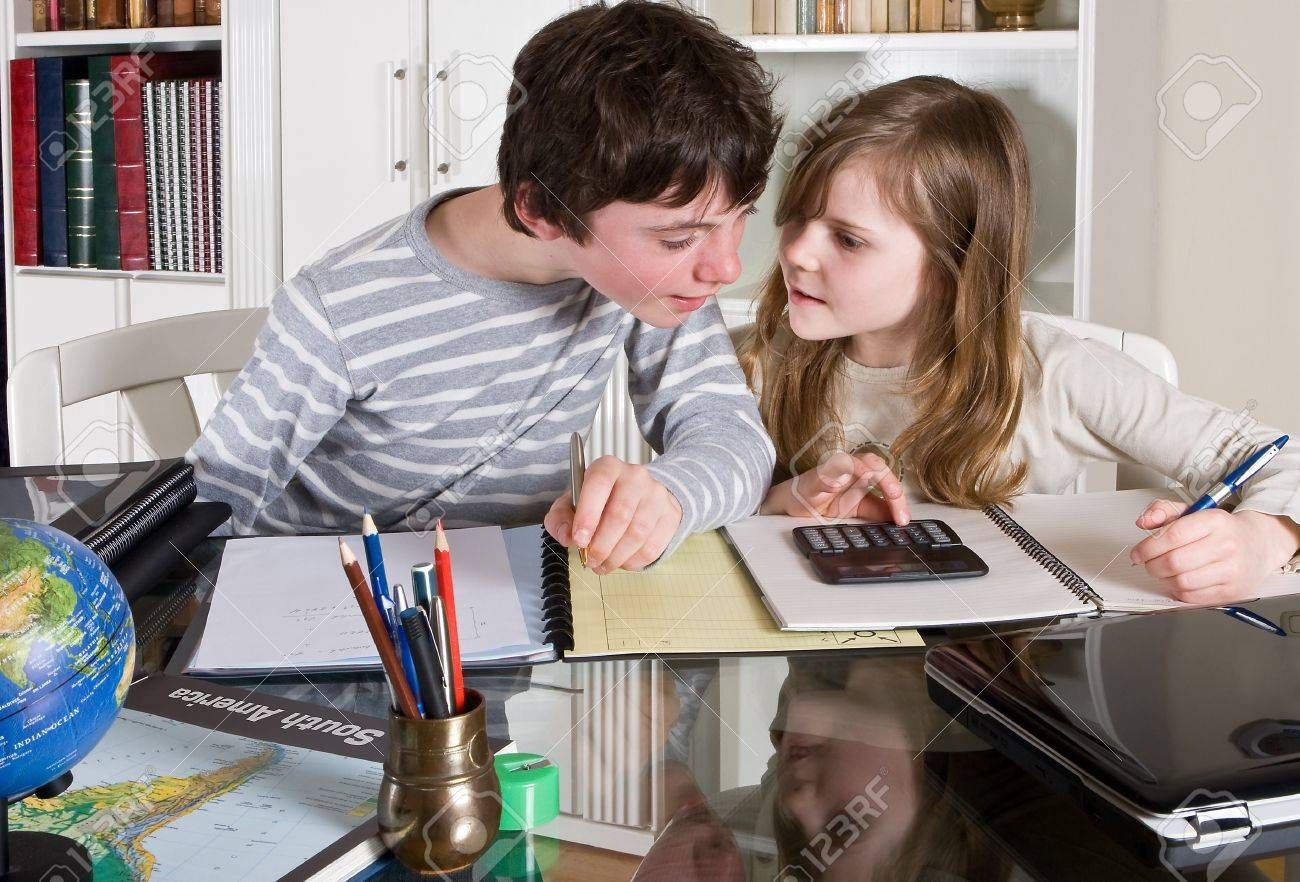 Two Teenager Kids Helping Each Other With Their Homework Stock ...
