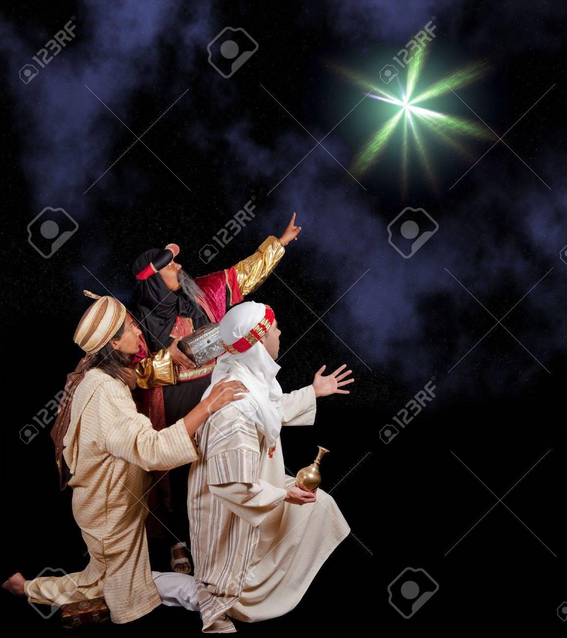 Wisemen Caspar Melchior and Balthasar following the star of Bethlehem Stock Photo - 7597766