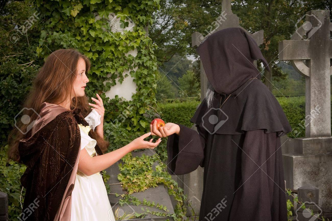 Halloween scene of an evil monk offering an apple Stock Photo - 7795455