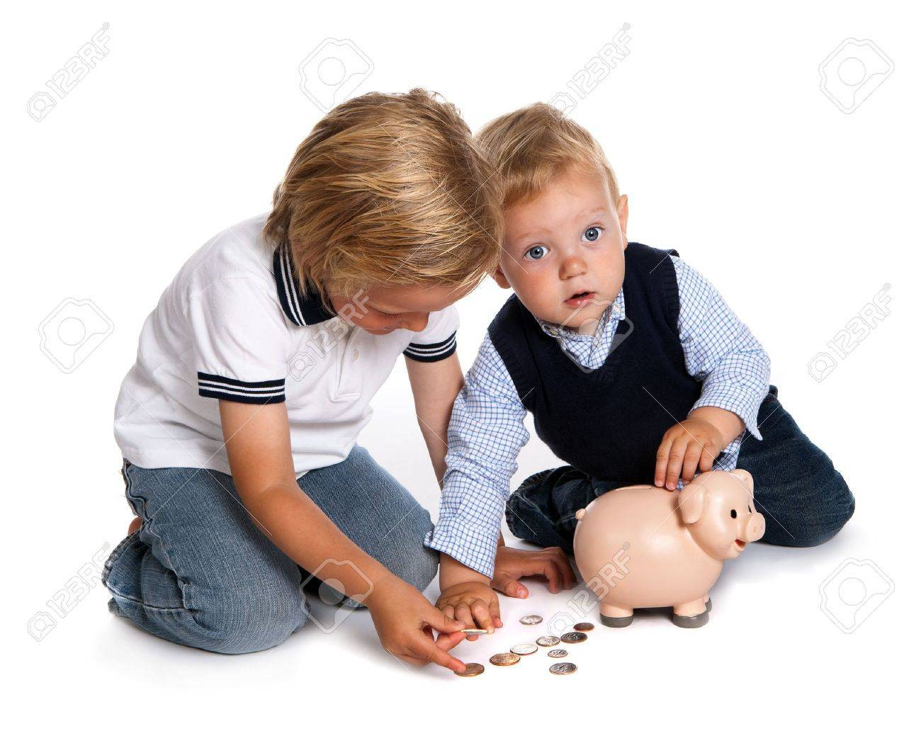 Two toddler brothers playing with money and their pink piggy bank Stock Photo - 8202042