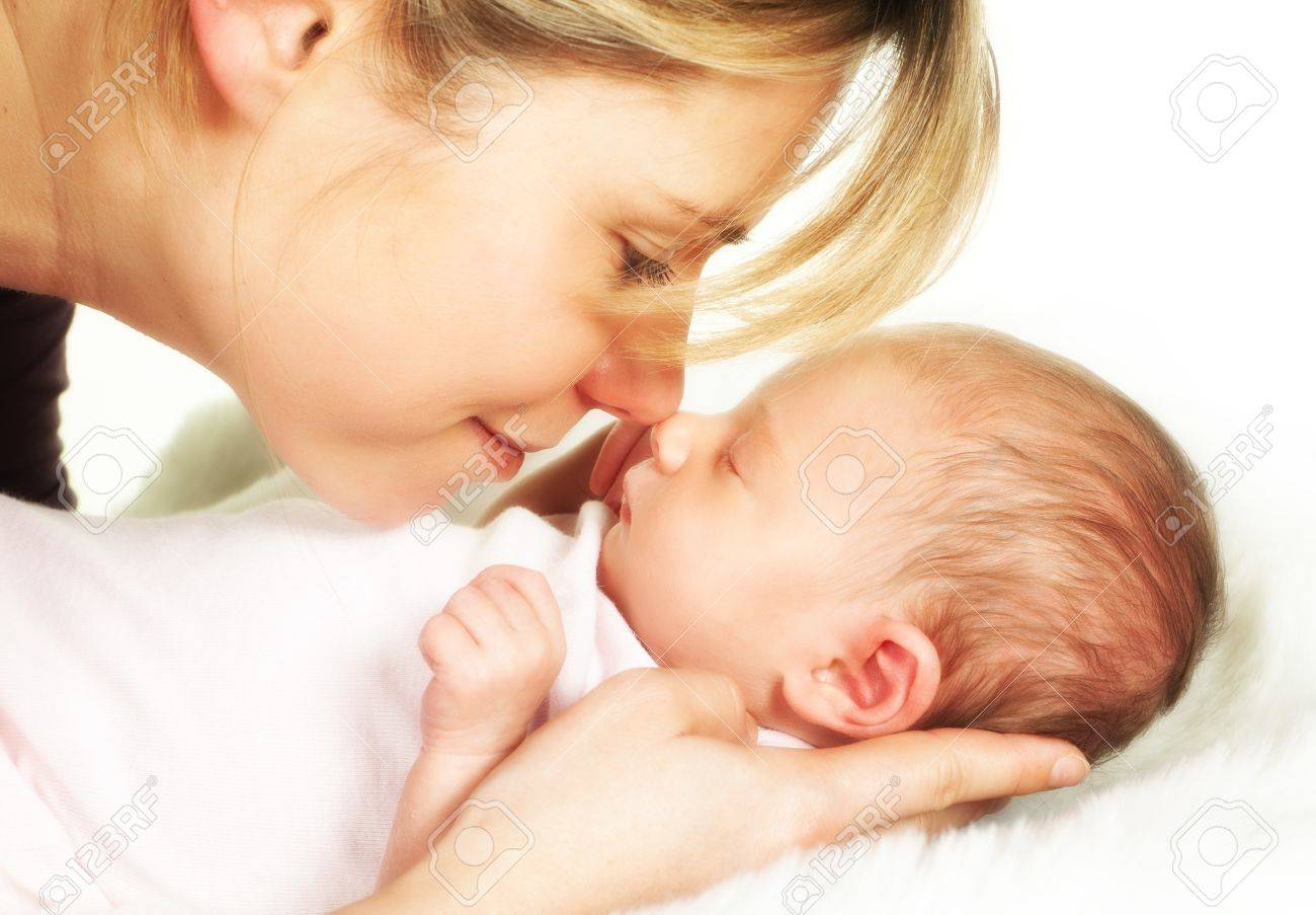 Moment of tenderness between a mother and her 18 days old baby Stock Photo - 9135339