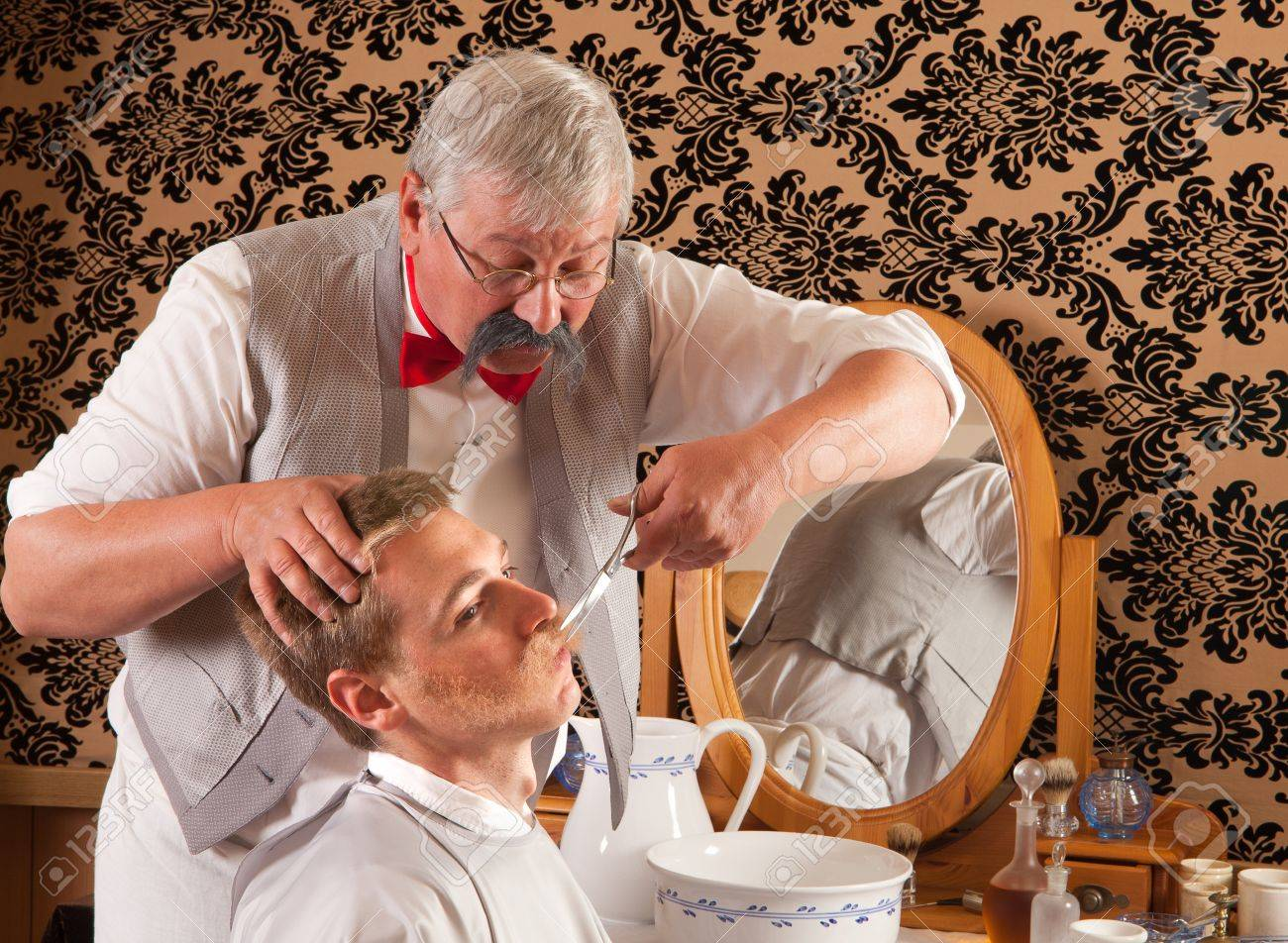Barber cutting the mustache of a customer in an antique victorian barbershop Stock Photo - 9600669