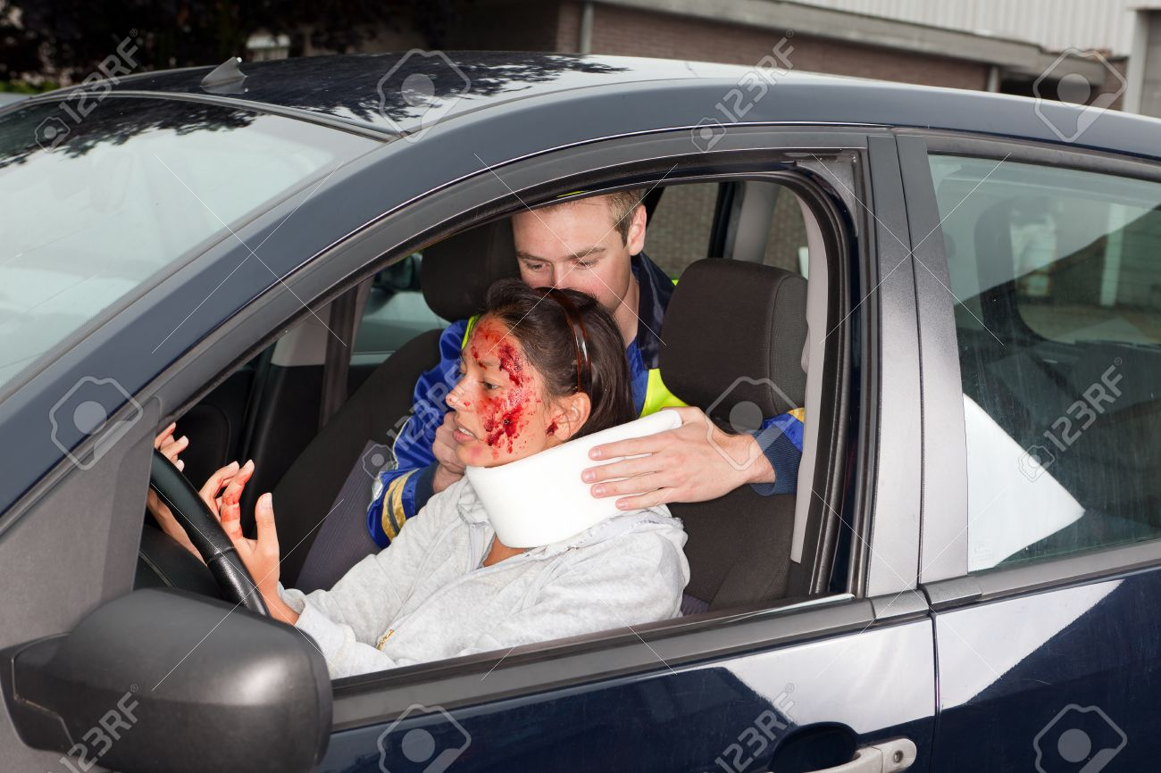 Injured woman in car crash getting a whiplash neck brace Stock Photo - 9944955