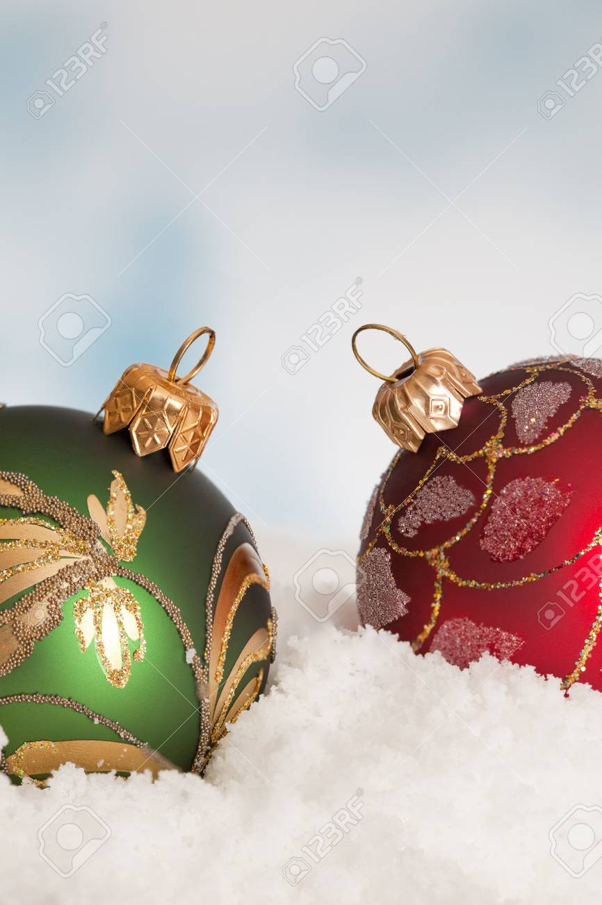 Two Red And Green Christmas Tree Decorations In The Snow Stock Photo Picture And Royalty Free Image Image 11072641