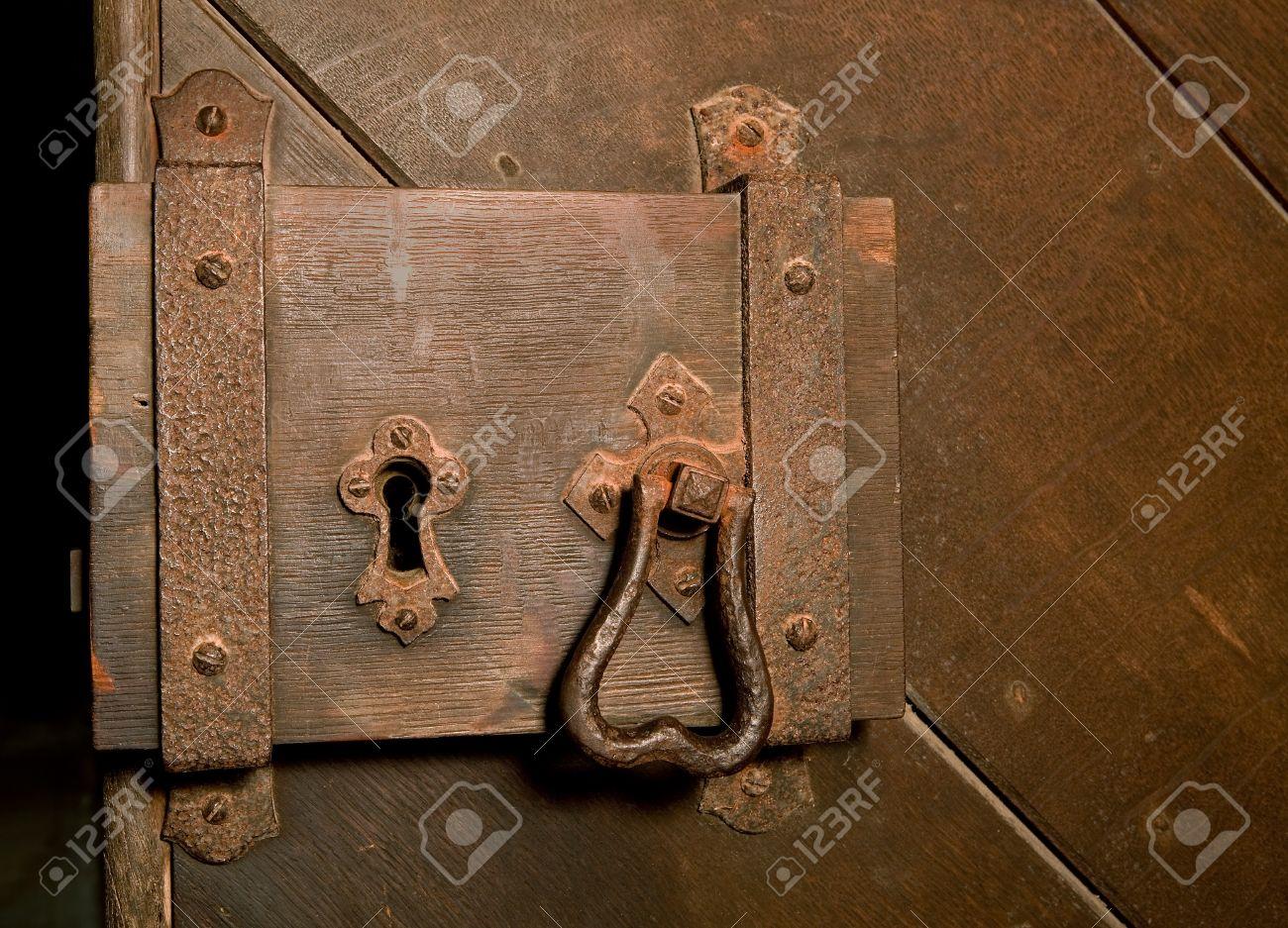 Antique rusty lock on a medieval wooden door Stock Photo - 11072258
