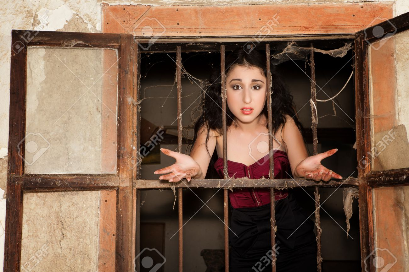 Woman behind bars asking why she is in prison Stock Photo - 11423602