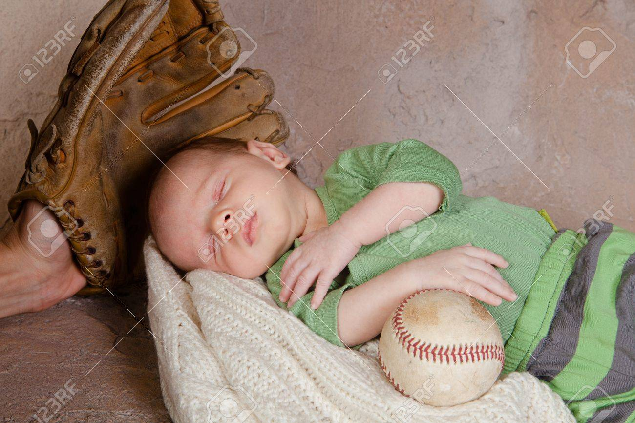 786a02a4f Newborn Baby Sleeping With Baseball And Glove Stock Photo