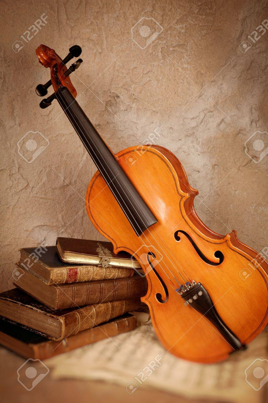 Empty room with chair violin and sheet music on floor photograph - Classic Literature Old Classical Violin With Antique Books And Grungy Sheet Music