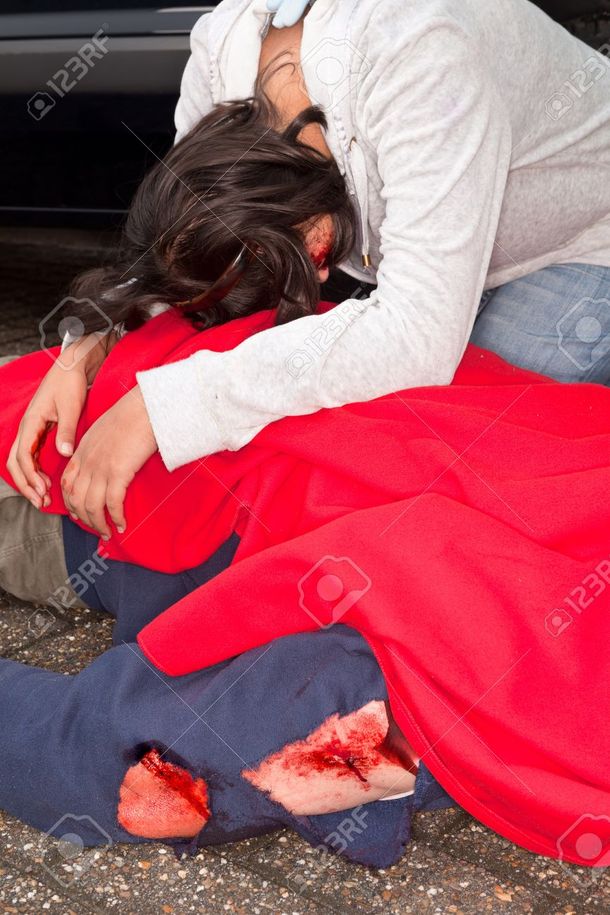 injured woman and dead body after a car accident stock photo 11960950