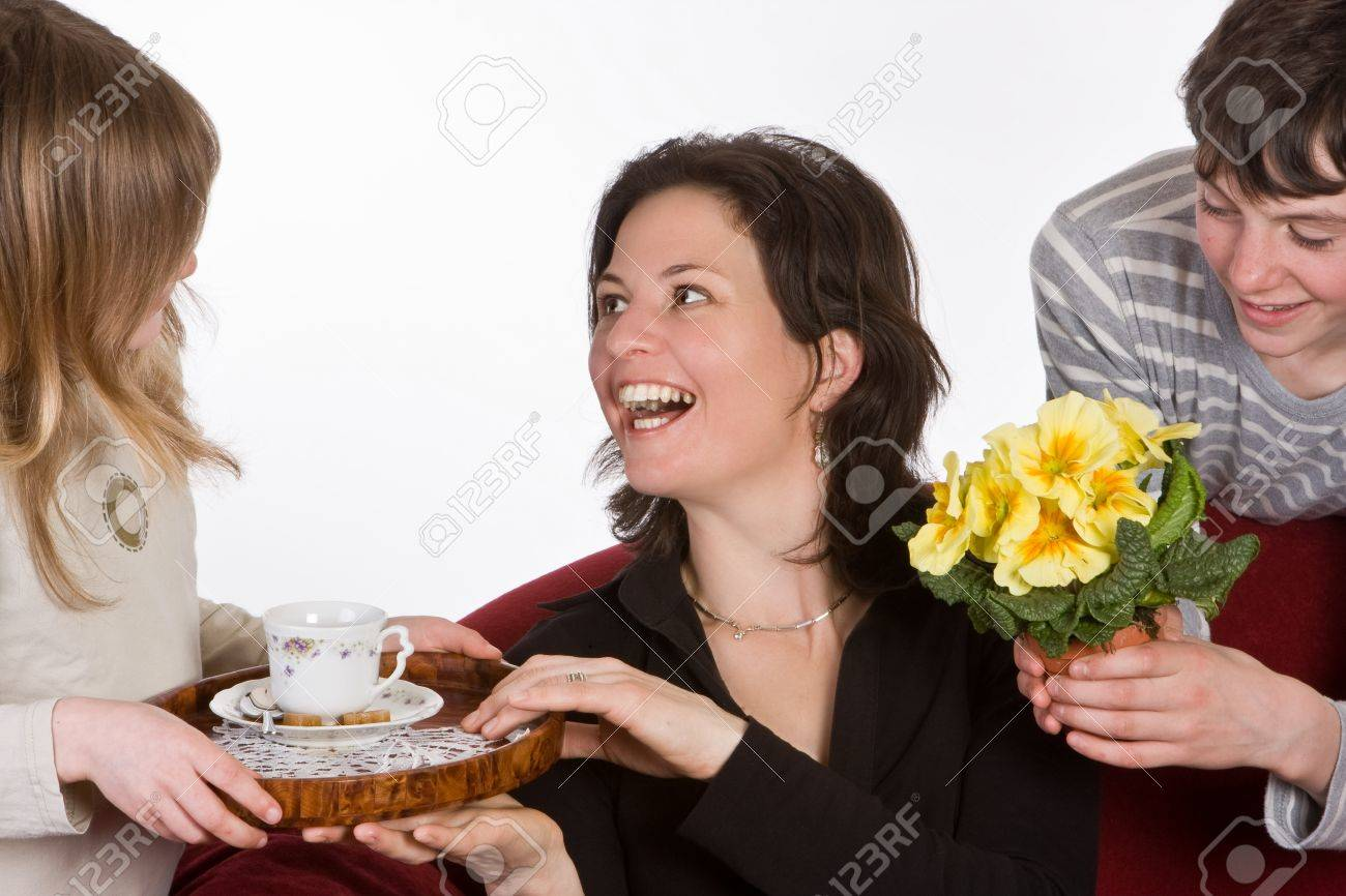 Happy mother receiving coffee and flowers on mother's day Stock Photo - 12911275