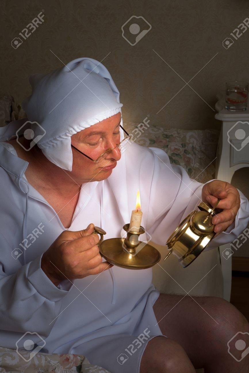 Elder vintage man checking the time with a candle Stock Photo - 14663920