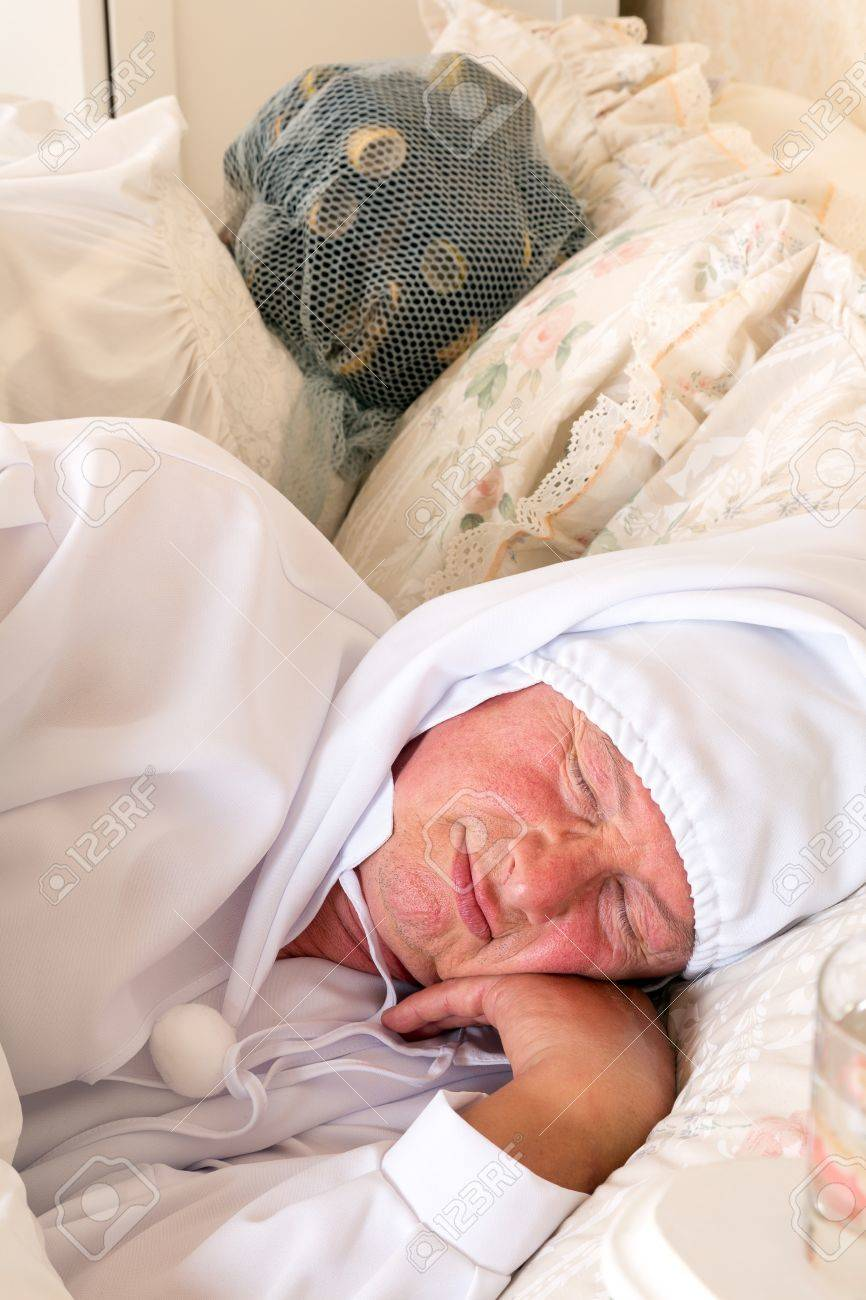 Funny retro image of an elderly couple in bed Stock Photo - 15831116