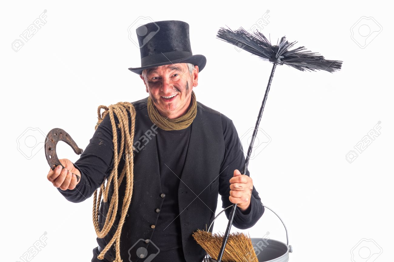 New Year image of a chimney sweep wishing good fortune with a horseshoe Stock Photo - 15921708