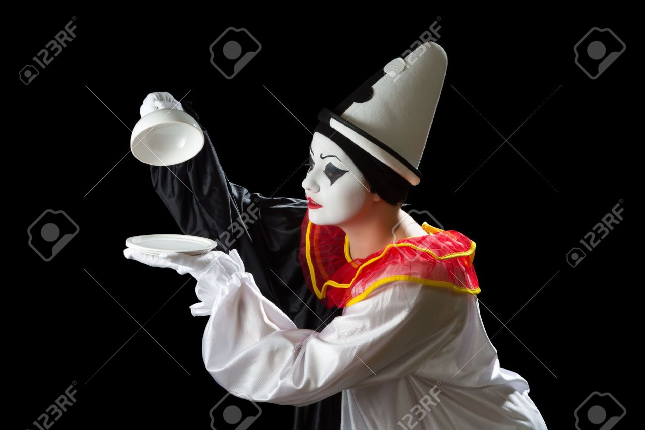 Surprised Pierrot clown uncovering an empty tray dish Stock Photo - 15921707