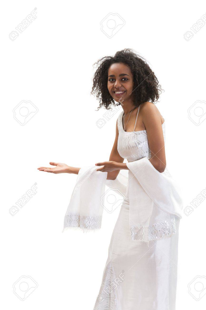 Smiling Ethiopian woman in traditional dress making a welcome sign Stock Photo - 18523002