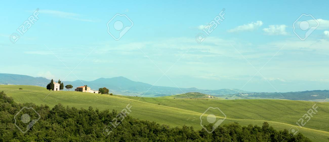 Panoramic view on the Tuscan hills near San Quirico d'Orcia with small chapel on rolling hills Stock Photo - 19420495