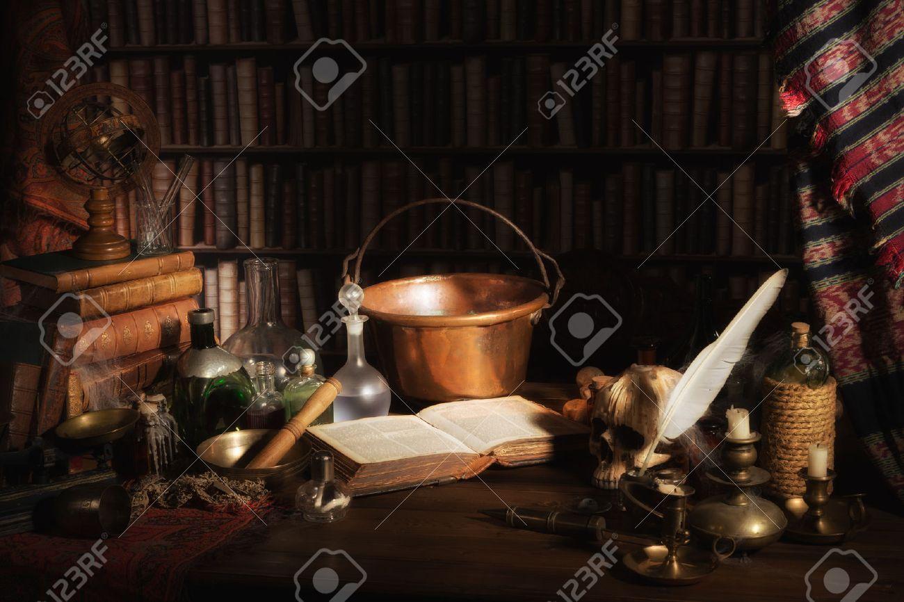 Halloween scene of a medieval alchemist kitchen or laboratory - 22444789