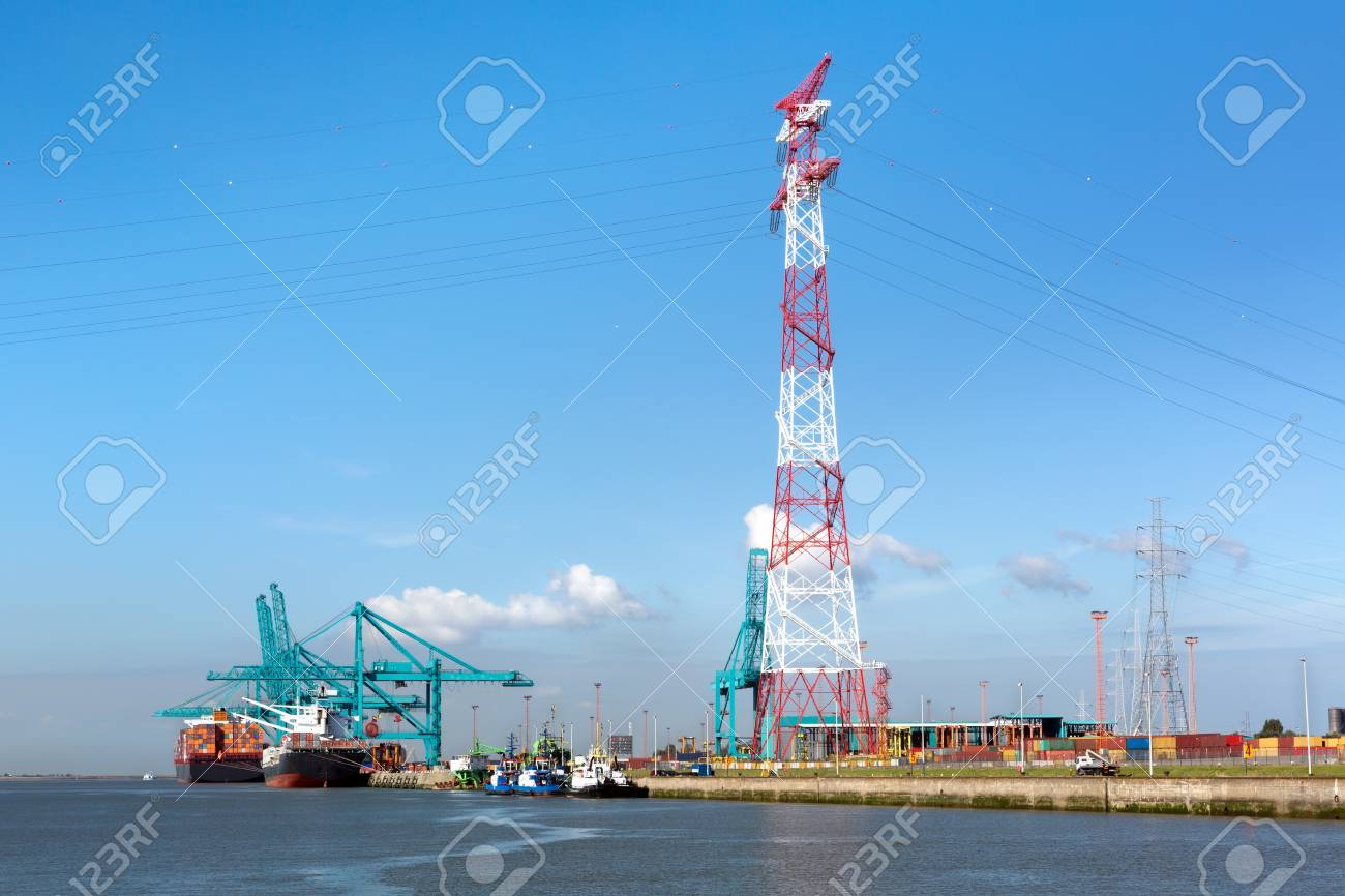 Huge container ships being loaded with cranes in Antwerp container terminal - all recognizable logos and brands have been removed Stock Photo - 23074925