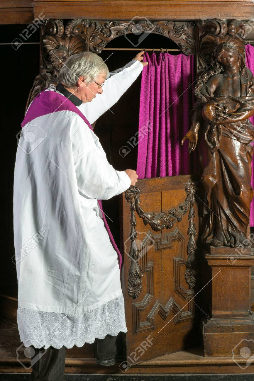 Priest in white surplice entering the confession booth of a 17th century medieval church Stock Photo - 22732875