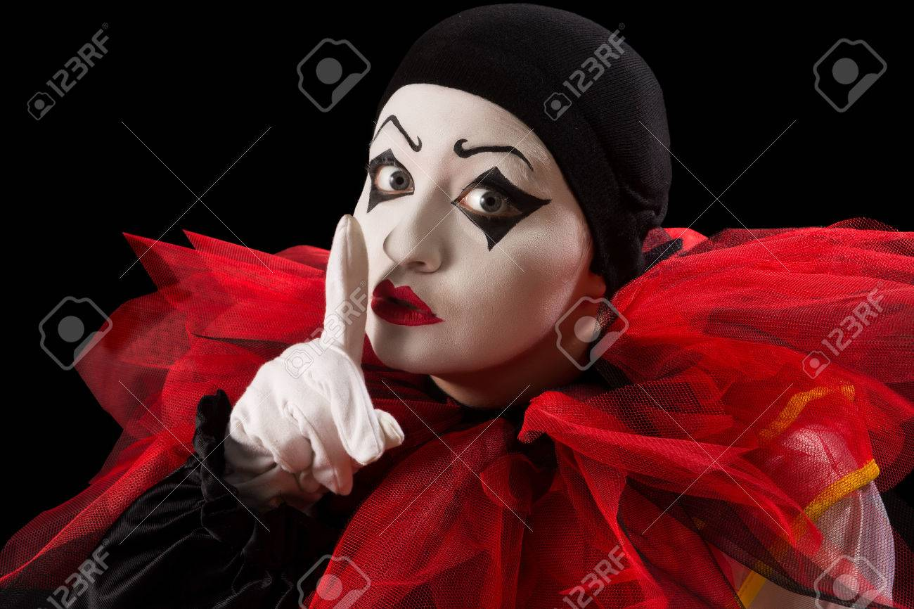 Funny Pierrot with her finger against her mouth Stock Photo - 23486800