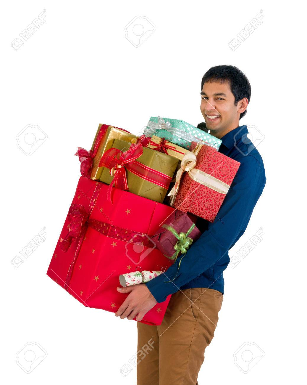 Happy Young Man Holding Too Many Christmas Presents Stock Photo ...