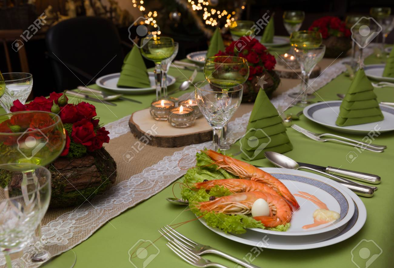 Festive dinner table with flower arrangements and decor napkins..