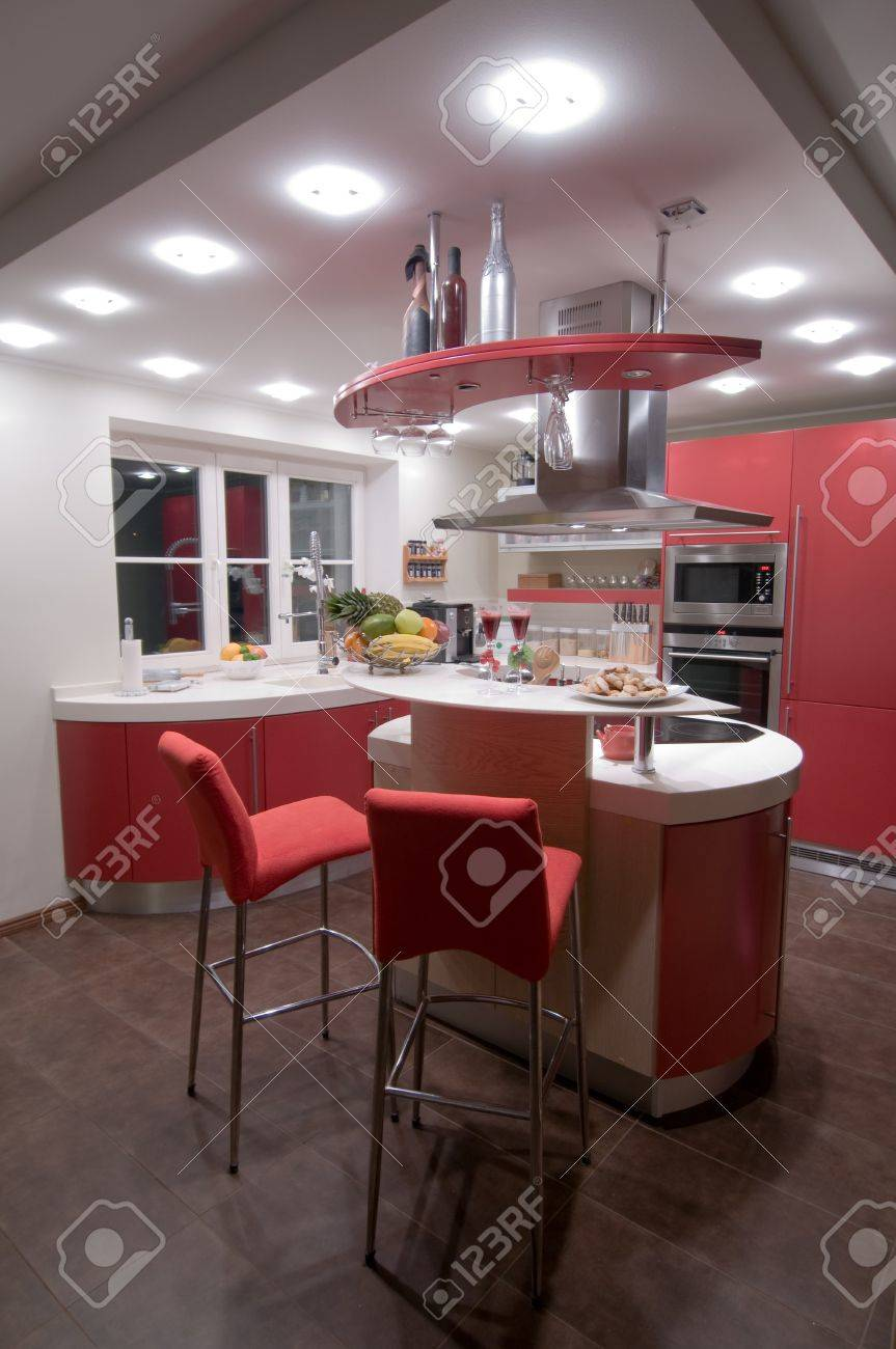 Red modern kitchen. Interiors. Cupboard. Table top. Stock Photo - 4352106