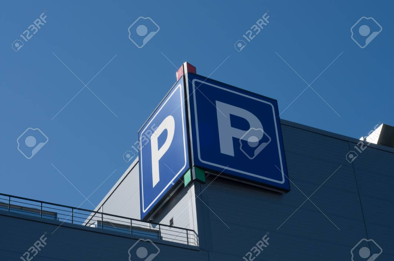 Parking sign on the morden building in the city Stock Photo - 5122962