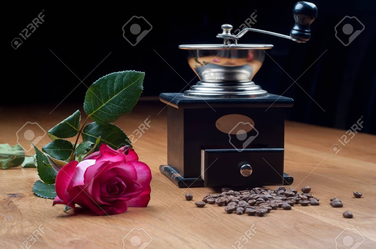 Old-fashioned manual burr-mill coffee grinder on wooden table Stock Photo - 22224607