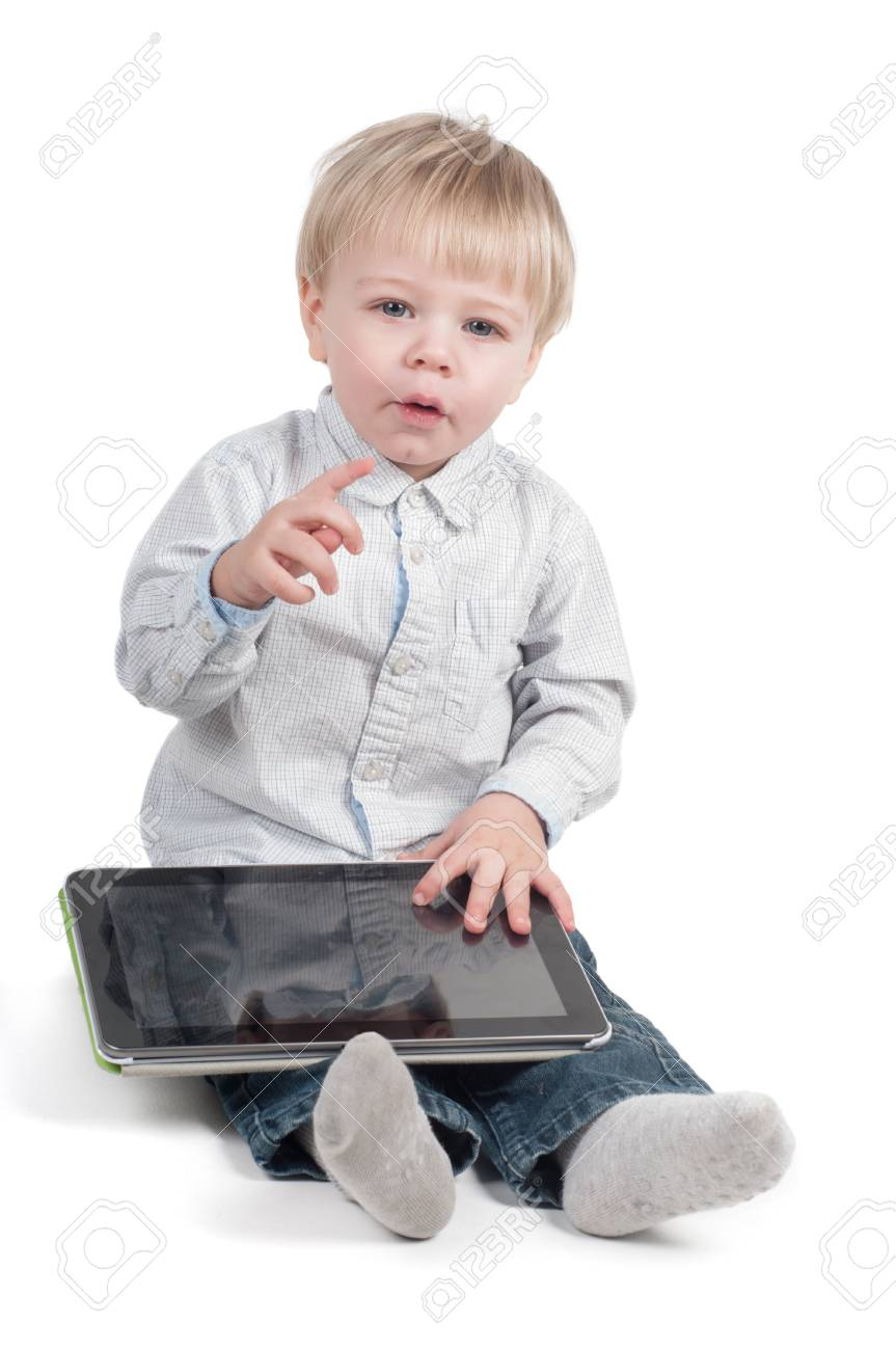 Little cute boy sitting with tablet computer on white background Stock Photo - 22217778