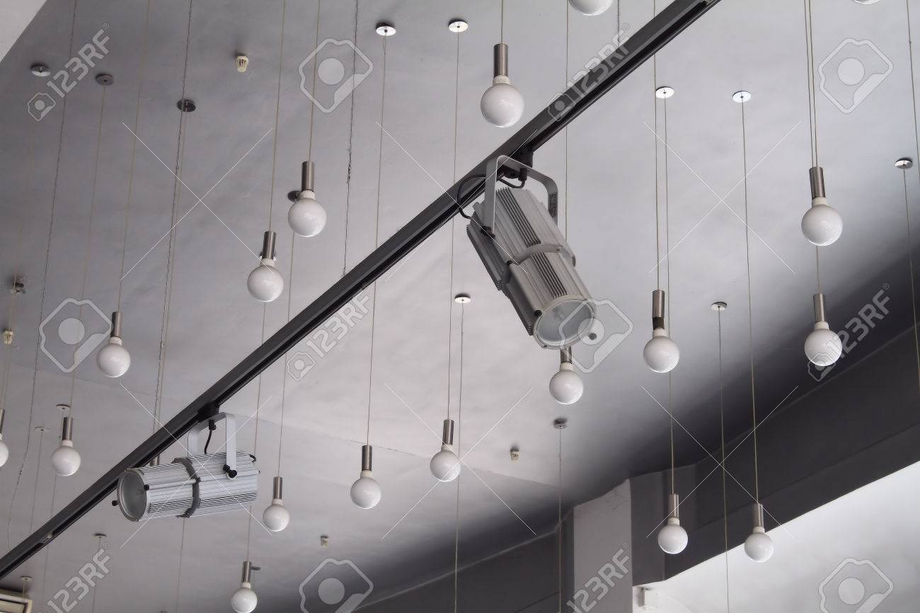 Lighting technology in studio with moving track spotlights and lighting technology in studio with moving track spotlights and ceiling lamps stock photo 45956926 aloadofball Choice Image