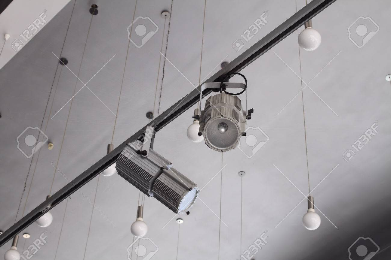 Lighting technology in studio with moving track spotlights and lighting technology in studio with moving track spotlights and ceiling lamps stock photo 45956927 aloadofball Choice Image