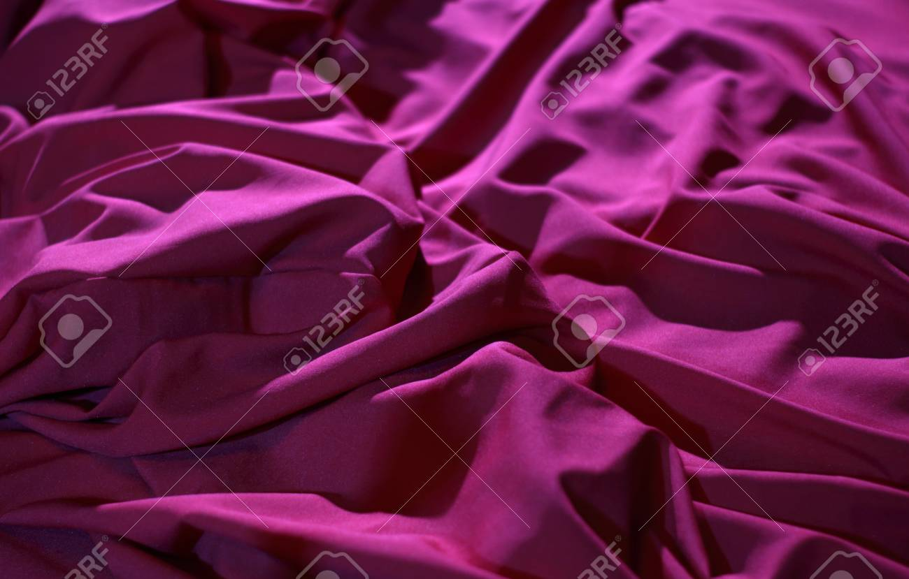 Bed Linen Shop. Wrinkles On The Red Silk Vail Detailed Stock Image Stock  Photo