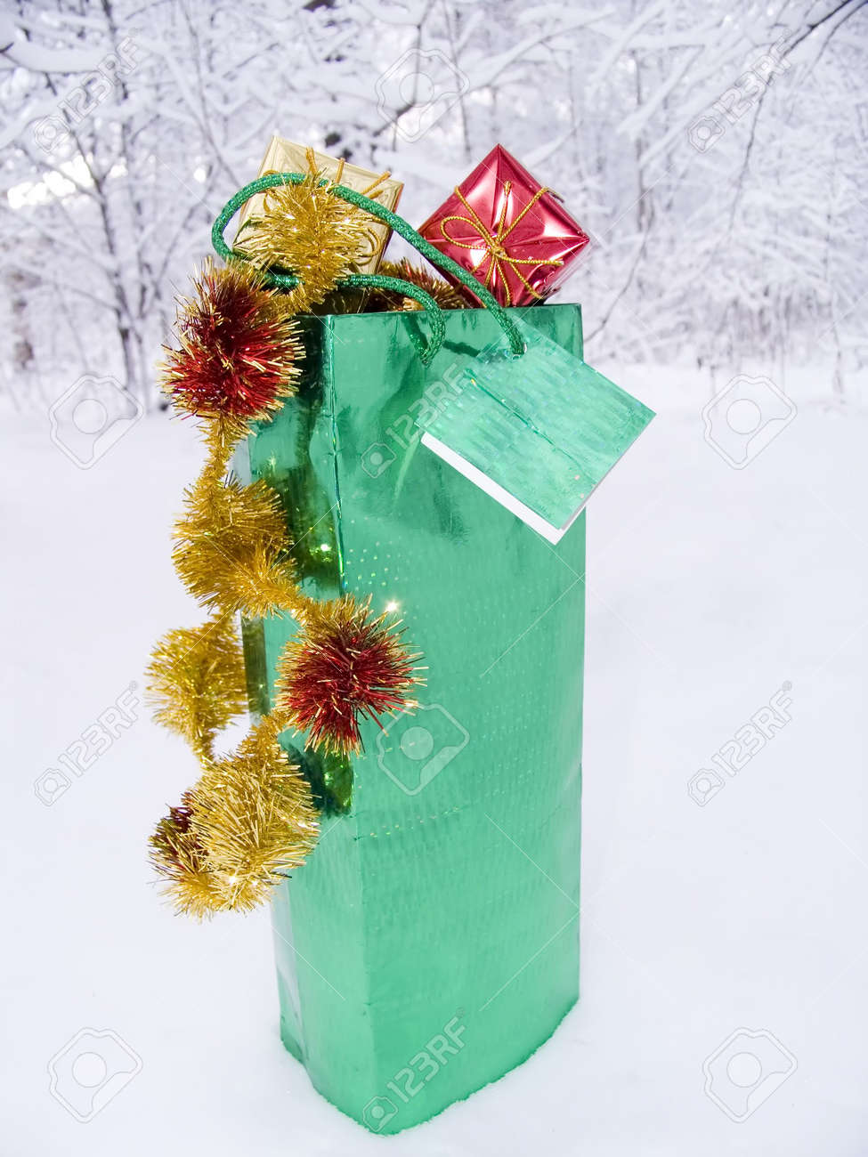 Box with gifts for Christmas on snow in a winter snow-covered wood Stock Photo - 609199