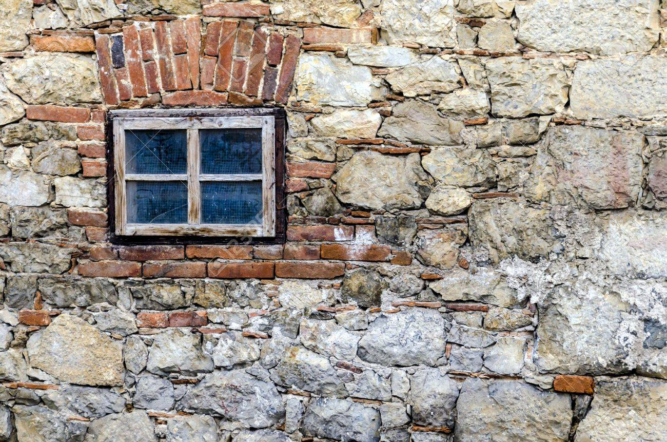 Small Window On A Stone Wall Of Old House Stock Photo Picture And