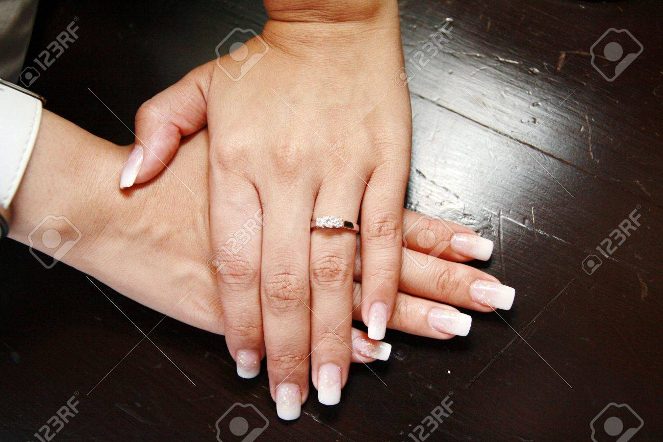 Asia women hands with wedding ring Stock Photo - 8918117