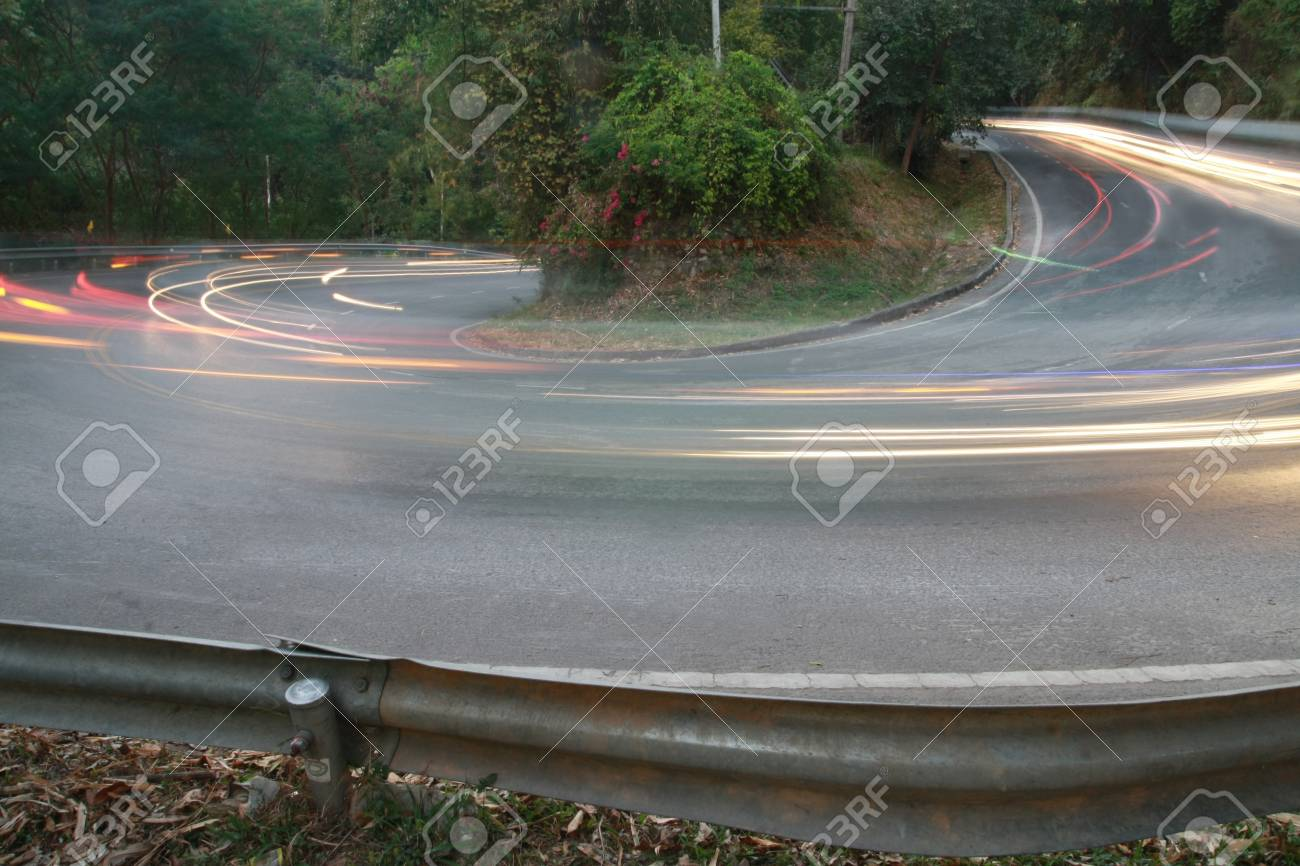 sharp curve road with car light line Stock Photo - 21095099