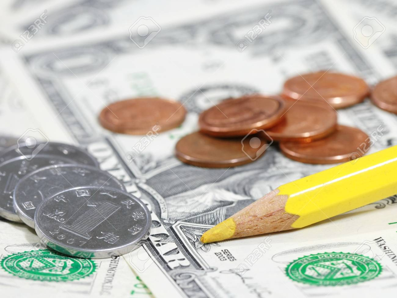 yellow pencil and coin on bill Stock Photo - 21094476
