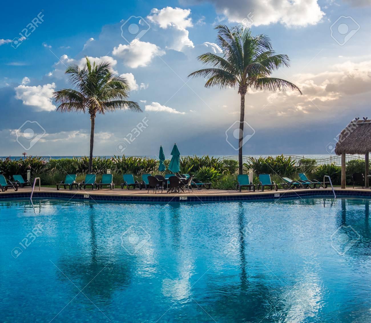 Empty pool at tropical resort at the morning - 69688577